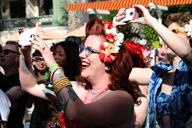 Mae Larous of Visalia, Calif., grabs a shot of the men's swimsuit competition at the Viva Las Vegas Rockabilly Weekend Pool Party at the Orleans hotel-casino on Friday, April 3, 2015. (Michael Qui ...