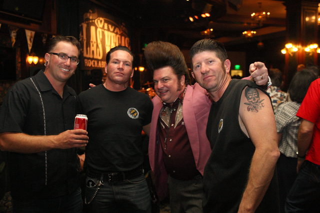 Members of the Greaser Social Club, Aaron Knowles, left, from Sydney, Australia, Johnny Falk from New York, Carl Schreiber and Steve Hendricks from Indiana, party down in Brendan's Pub at the Viva ...