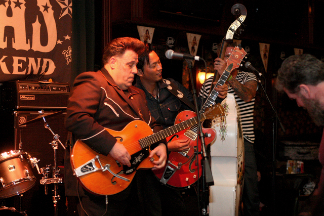 Roy Wilson, left, of The Buzzards from Long Island, New York, trades off licks with Eitaro Sako from North Hollywood, Calif. in Brendan's Pub at the Viva Las Vegas Rockabilly Weekend in the Orlean ...