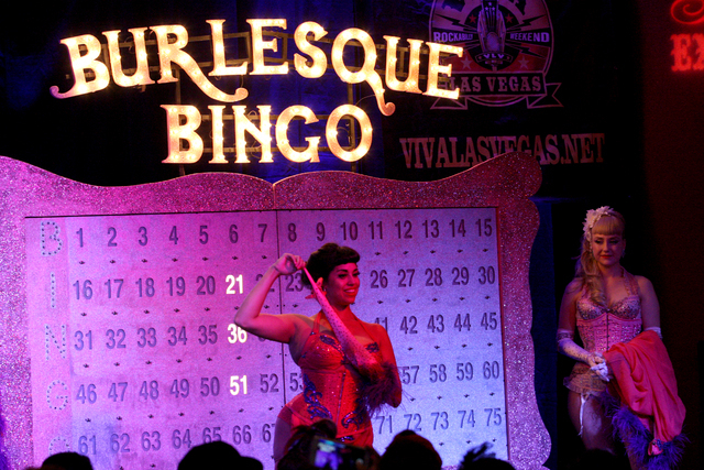 Coco Lectric taunts the audience as she removes a glove during Burlesque Bingo at the Viva Las Vegas Rockabilly Weekend in the Orleans hotel-casino on Saturday, April 4, 2015. (Michael Quine/Las V ...