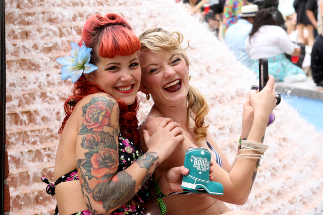 Autumn Tselios and Sage Quayle, both from Seattle, Wa., enjoy the final hours of the Viva Las Vegas Rockabilly Weekend Pool Party at the Orleans hotel-casino on Sunday, April 5, 2015. (Michael Qui ...