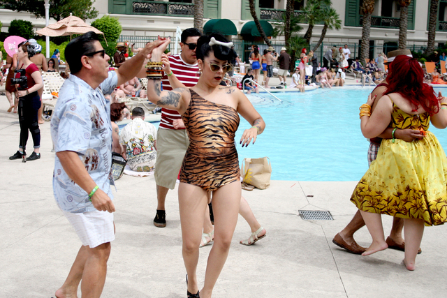 Jose Aviles and Yasmin Bane from Los Angeles, Ca. dance poolside at the Viva Las Vegas Rockabilly Weekend Pool Party at the Orleans hotel-casino on Sunday, April 5, 2015. (Michael Quine/Las Vegas  ...