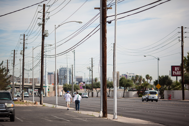Pedestrians walk along Industrial Road near Circus Circus Drive in Las Vegas on Tuesday, March 17, 2015. Cassandra Rosete was found dead on Nov. 22 on the sidewalk of the 2600 block of Industrial  ...