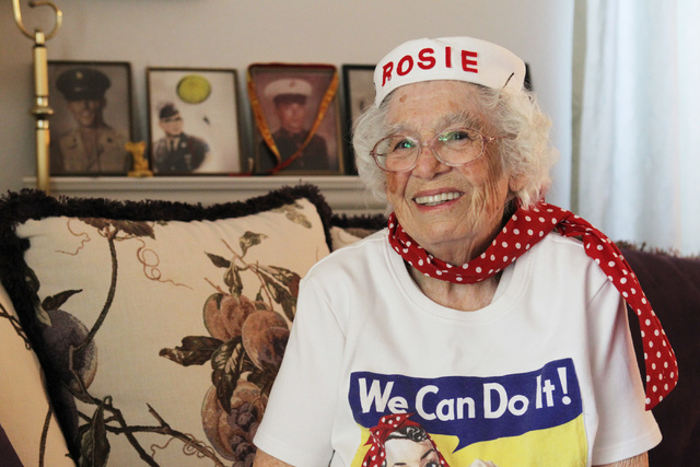 Carmella Wood wears a Rosie the Riveter T-shirt April 8, 2015. Behind her are portraits of her three sons, who served in the military. (Sam Morris/View)