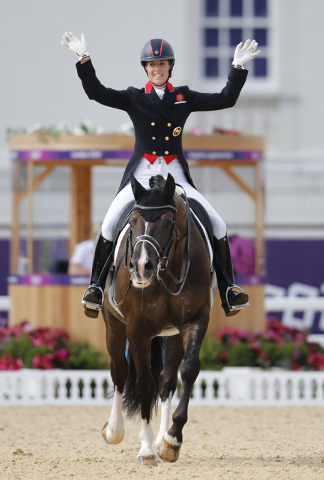 Charlotte Dujardin of Britain riding Valegro waves after the equestrian Dressage Individual Grand Prix Freestyle at the 2012 Olympic Games in London. The pair won gold medals in the individual and ...