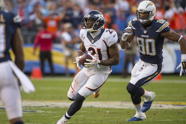 Dec 14, 2014; San Diego, CA, USA; Denver Broncos cornerback Aqib Talib (21) intercepts a pass intend for San Diego Chargers wide receiver Malcom Floyd (80) during the fourth quarter at Qualcomm St ...