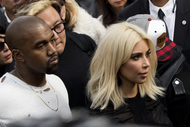 Television personality Kim Kardashian and rapper Kanye West during Paris Fashion Week March 11, 2015. (Gonzalo Fuentes/Reuters)