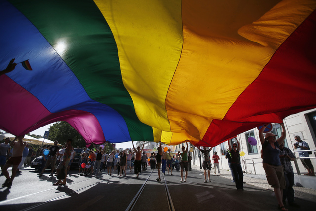 Participants carry a rainbow flag as they march during a Gay Pride Parade in downtown Lisbon June 22, 2013. (Rafael Marchante/Reuters)