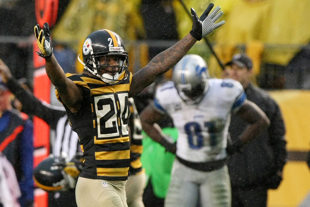 Nov 17, 2013; Pittsburgh, PA, USA; Pittsburgh Steelers cornerback Ike Taylor celebrates an interception as Detroit Lions Calvin Johnson (81) reacts during the second half at Heinz Field. Pittsburg ...