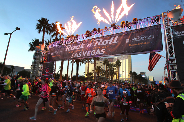 A group of runners cross the start line in the Las Vegas Rock 'n' Roll Marathon and half marathon on the Strip on Sunday, Nov. 16, 2014. (K.M. Cannon/Las Vegas Review-Journal)