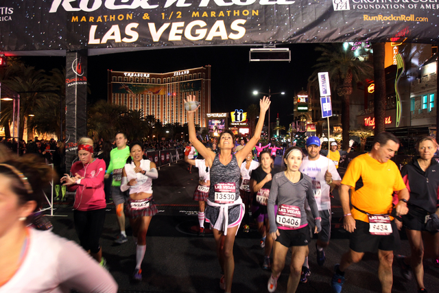 Runners cross the half marathon finish line in the Las Vegas Rock 'n' Roll Marathon and half marathon on the Strip on Sunday, Nov. 16, 2014. (K.M. Cannon/Las Vegas Review-Journal)