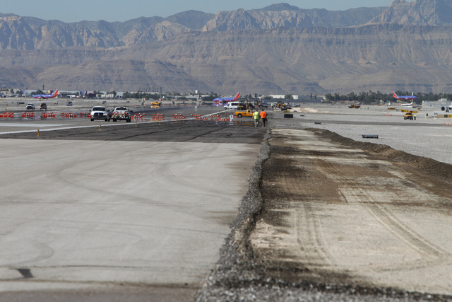 Construction crews work on the tarmac at McCarran International Airport in Las Vegas Wednesday, Oct. 29, 2014. The east west runway at the airport begun the first phase of a $67 million renovation ...