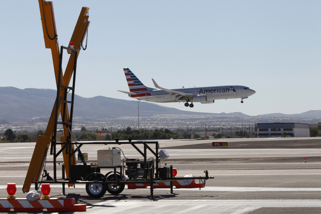 A plane approaches the tarmac for landing at McCarran International Airport in Las Vegas Wednesday, Oct. 29, 2014. The east west runway at the airport begun the first phase of a $67 million renova ...