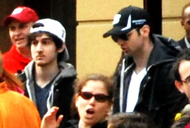 Photos released by Bob Leonard show the Tsarnaev brothers behind barricades at the 2013 Boston Marathon before the bombs went off. (File)