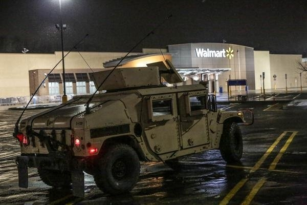 A Wal-mart store is guarded by the Missouri National Guard on Nov. 26. (Lawrence Bryant/St. Louis American)