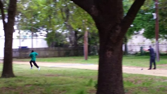 This still, released by the family of Walter Scott, appears to show North Charleston, South Carolina police officer Michael Slager shooting Scott in the back as he ran away from the officer. The i ...