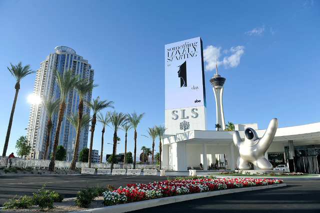 """Philippe Starck's sculpture """"Saam by Starck"""" , lower right, is displayed at the front entrance at SLS Las Vegas during the grand opening celebration on Friday, Aug. 22, 2014.  (David Becker/Las Ve ..."""