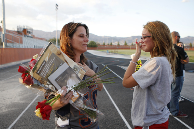 Jamie Diedrich, mother of Joshua Phillips who died in an U.S. Army airborne training accident, shares a moment with his son's former girlfriend Alysa Cool during a candle light vigil for her son a ...
