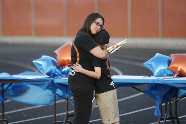Erika Newton embraces her son Danny during a candle light vigil for Newton's nephew Joshua Phillips, 19, at the Legacy High School football field in North Las Vegas Sunday, April 19, 2015. Phillip ...