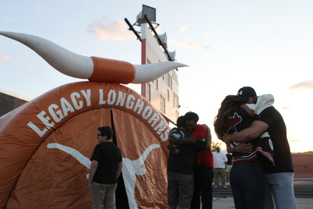 People embrace during a candle light vigil for Joshua Phillips, 19, at the Legacy High School football field in North Las Vegas Sunday, April 19, 2015. Joshua Phillips, who died in an U.S. Army ai ...