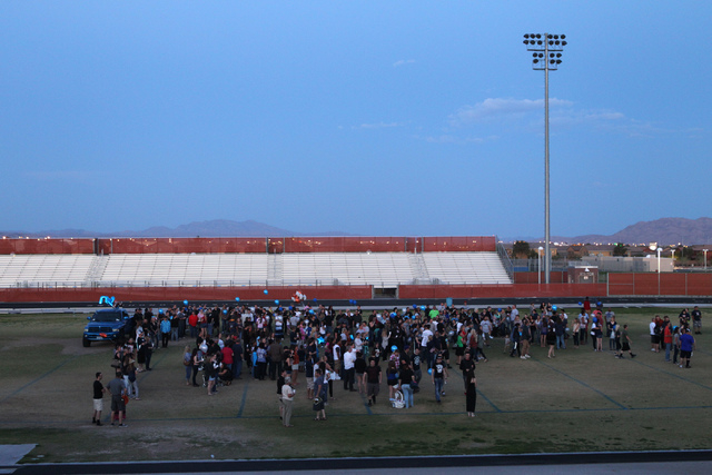 People gather for a candle light vigil for Joshua Phillips, 19, at the Legacy High School football field in North Las Vegas Sunday, April 19, 2015. Joshua Phillips, who died in an U.S. Army airbor ...