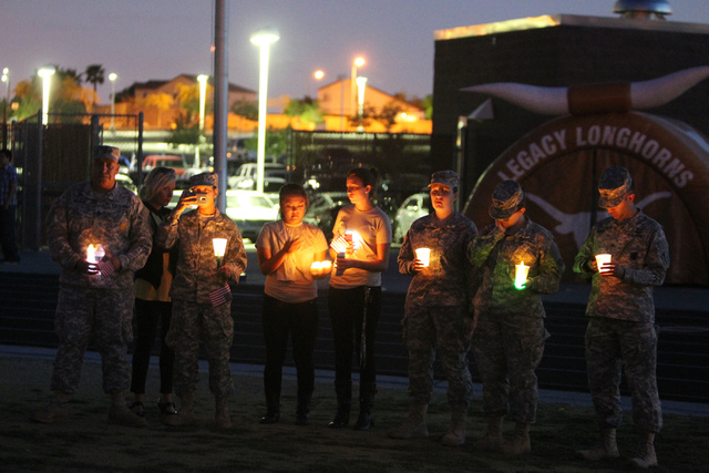 People including military personnel gather for a candle light vigil for Joshua Phillips, 19, at the Legacy High School football field in North Las Vegas Sunday, April 19, 2015. Joshua Phillips, wh ...