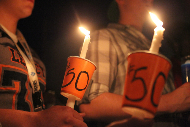 People participate during a candle light vigil for Joshua Phillips, 19, at the Legacy High School football field in North Las Vegas Sunday, April 19, 2015. Joshua Phillips, who died in an U.S. Arm ...