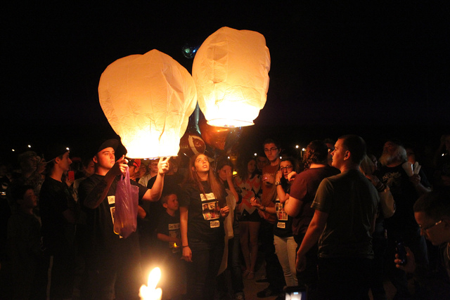 Hot air balloons are released during a candle light vigil for Joshua Phillips, 19, at the Legacy High School football field in North Las Vegas Sunday, April 19, 2015. Joshua Phillips, who died in  ...