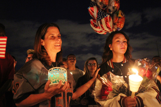 Jamie Diedrich, left, with his son's wife Karlee, remember her son Joshua Phillips, 19, who died in an U.S. Army airborne training accident, during a candle light vigil for her son at the Legacy H ...