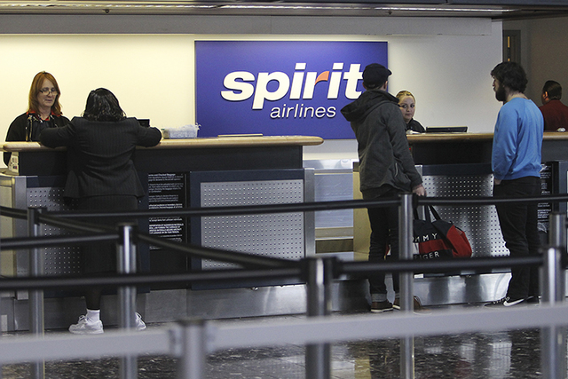 Customers file through the Spirit Airlines ticketing counter at McCarran International Airport in Las Vegas on Feb. 7, 2012. (Jason Bean/Las Vegas Review-Journal)