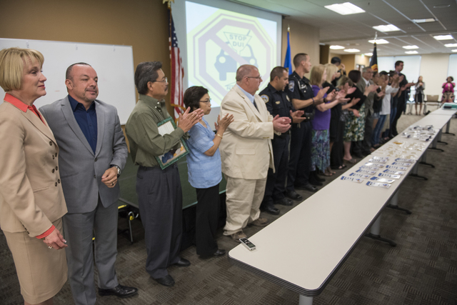 Victim family members are acknowledged during the Ride Genie Sponsors Stop DUI 2nd annual Hero's & Handcuffs event at Las Vegas Metro Headquarters on 400 Martin Luther King Blvd in Las Vegas on Su ...