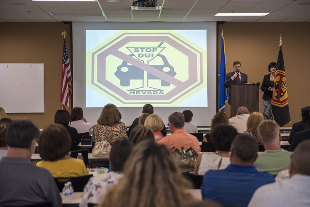 Nevada State Senator Mark Manendo, at podium, speaks during the Ride Genie Sponsors Stop DUI 2nd annual Hero's & Handcuffs event at Las Vegas Metro Headquarters on 400 Martin Luther King Blvd in L ...