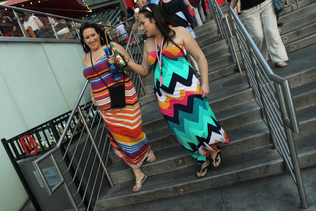 Tourists leave Planet Hollywood with a souvenir drink glass and a glass beer bottle, Saturday, April 4, 2014. (Sam Morris/Las Vegas Review-Journal) Follow Sam Morris on Twitter @sammorrisRJ