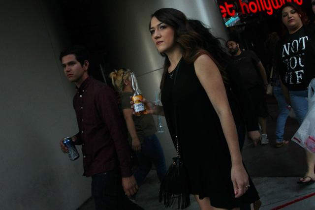 A pedestrian carries a glass beer bottle on the Strip, Saturday, April 4, 2014. (Sam Morris/Las Vegas Review-Journal) Follow Sam Morris on Twitter @sammorrisRJ