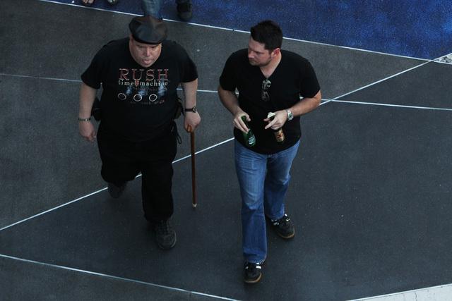 A man carries two beer bottles on the Strip, Saturday, April 4, 2014. (Sam Morris/Las Vegas Review-Journal) Follow Sam Morris on Twitter @sammorrisRJ