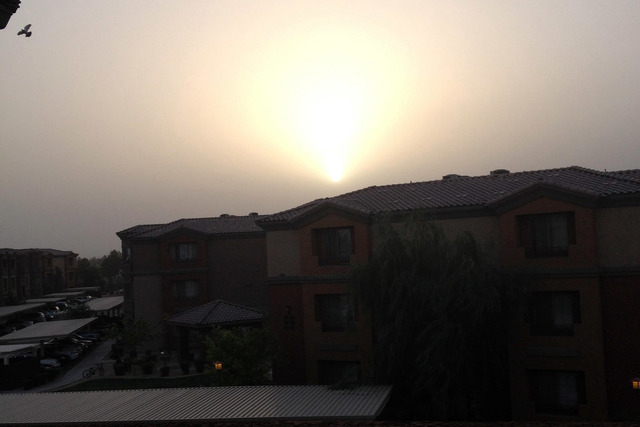 Sunset through the dust, seen from North Las Vegas. (Courtesy Judy Bryce/At the Scene)