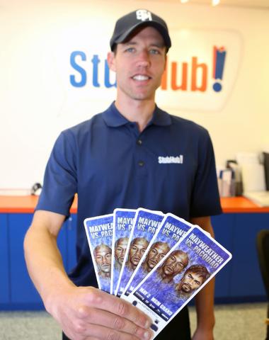StubHub Manager Nick Gray holds Mayweather-Pacquiao megafight tickets at his office at 4801Dean Martin Drive on Thursday April 30, 2015. (Bizuayehu Tesfaye/Las Vegas Review-Journal) Follow Bizu Te ...