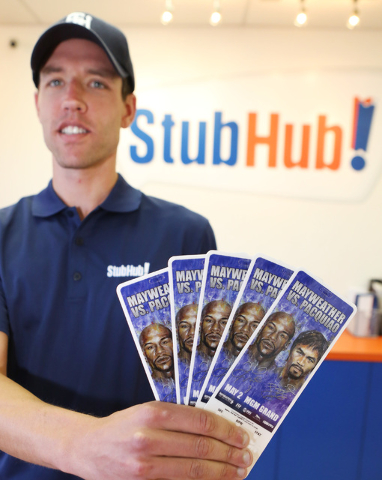 StubHub Manager Nick Gray holds Mayweather-Pacquiao megafight tickets at his office at 4801Dean Martin Drive on Thursday April 30, 2015. (Bizuayehu Tesfaye/Las Vegas Review-Journal) Follow Bizu Te ...