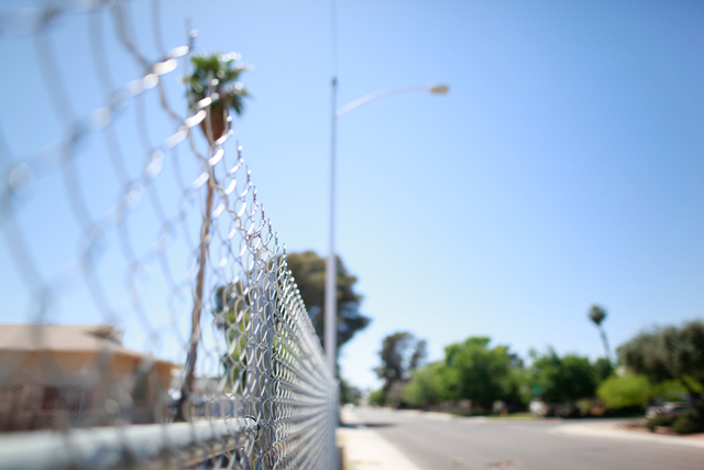 A fence is seen at an empty lot between homes along Loch Lomond Way in Las Vegas on Monday, April 13, 2015. Homes on the east side of the street abut Interstate 15, which would be widened as part  ...
