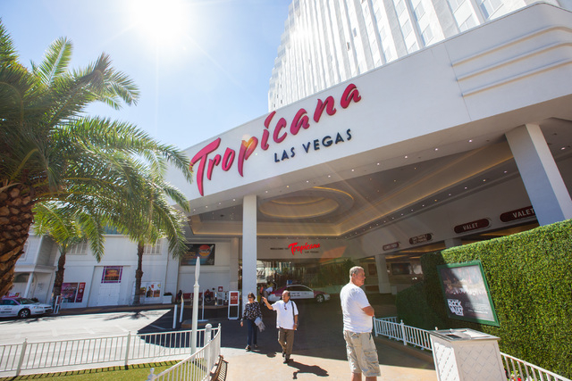 People walk outside of the Tropicana hotel-casino in Las Vegas on Wednesday, April 29, 2015. Penn National Gaming announced an agreement to acquire the Tropicana for $360 million. (Chase Stevens/L ...