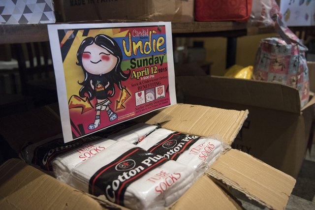 Boxes of donations are stacked during Caridad Humanizing the Homeless sock and underwear drive for the homeless held at Nacho Daddy in Downtown Las Vegas on Sunday, Apr. 12, 2015. (Martin S. Fuent ...