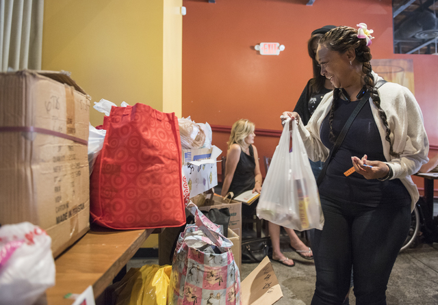 Rosalind Searcy drops off a donation bag during Caridad Humanizing the Homeless sock and underwear drive for the homeless held at Nacho Daddy in Downtown Las Vegas on Sunday, Apr. 12, 2015. (Marti ...