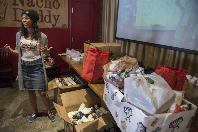President/CEO Merideth Spriggs of Caridad Humanizing the Homeless, speaks to guests who donated during a sock and underwear drive for the homeless held at Nacho Daddy in Downtown Las Vegas on Sund ...