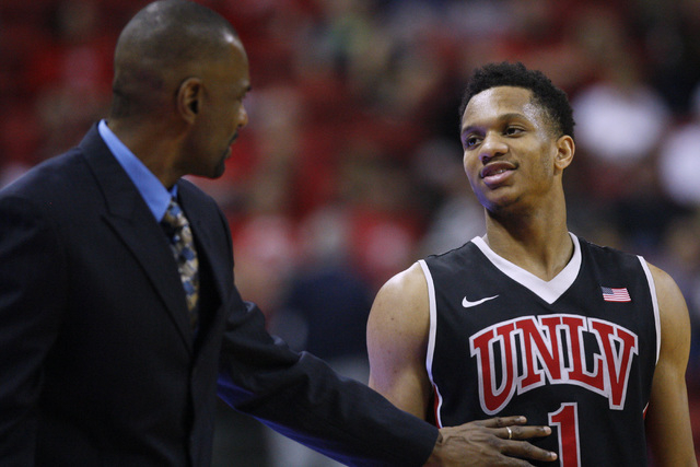 UNLV guard Rashad Vaughn talks to assistant coach Stacey Augmon during the second half of their Mountain West Conference game Saturday, Jan. 31, 2015 at the Thomas & Mack Center.  UNLV won the gam ...
