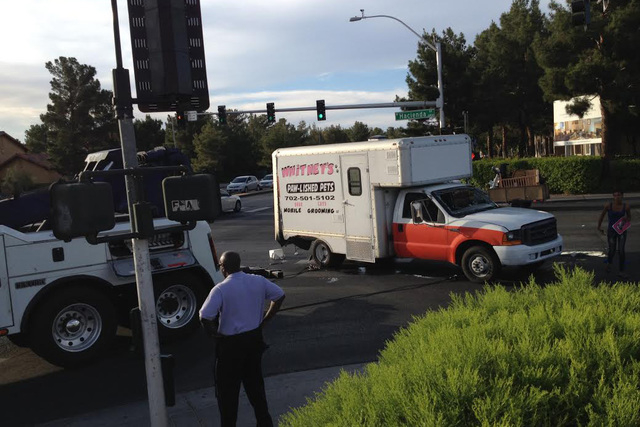 A moving van sits upright at the corner of Rainbow Boulevard and Hacienda Avenue after a tow truck operator pulled it off its side on Thursday, April 30, 2015. (Greg Haas/Las Vegas Review-Journal)