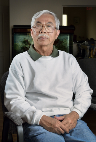 Vietnamese immigrant and former South Vietnamese serviceman Khang Nguyen recalls the hectic days getting out of Vietnam as Saigon fell during an interview at the Vietmy Service Center at 5700 Spri ...