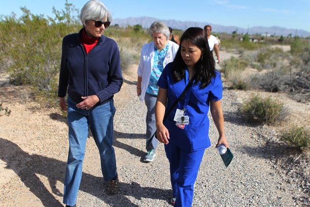 Cheryl Keown, left, walks with University Medical Center transplant Chris Josim, registered nurse coordinator, during the University Medical Center and Springs Preserve sponsored event Walk with a ...