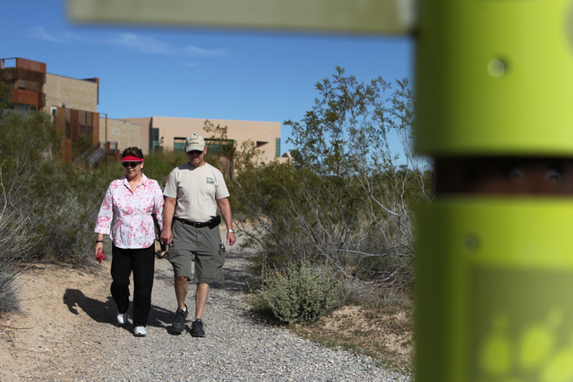 Barbara Johnsen, left, walks with her partner Jerry Owens during the University Medical Center and Springs Preserve sponsored event Walk with a Doc program at the Springs Preserve on Thursday, Mar ...
