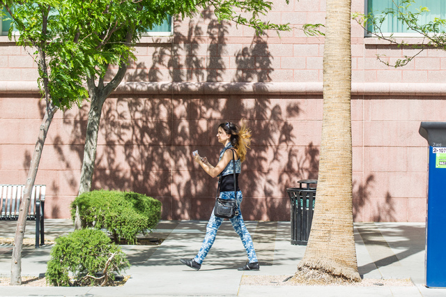 A woman's hair is blown by the wind along 3rd Street near Lewis Avenue on Tuesday, April 14, 2015. (Chase Stevens/Las Vegas Review-Journal) Follow Chase Stevens on Twitter @csstevensphoto