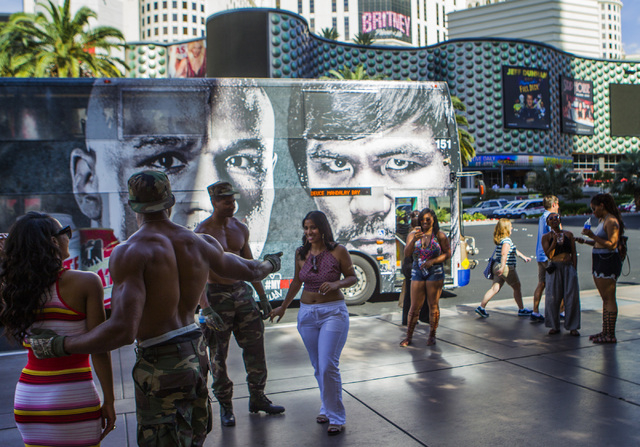 Street performers pose for photos on Las Vegas Boulevard near the Cosmopolitan on Thursday, April 30,2015.  (Jeff Scheid/Las Vegas Review-Journal) Follow Jeff Scheid on Twitter @jlscheid
